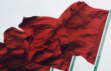 Red flags waving in the wind
